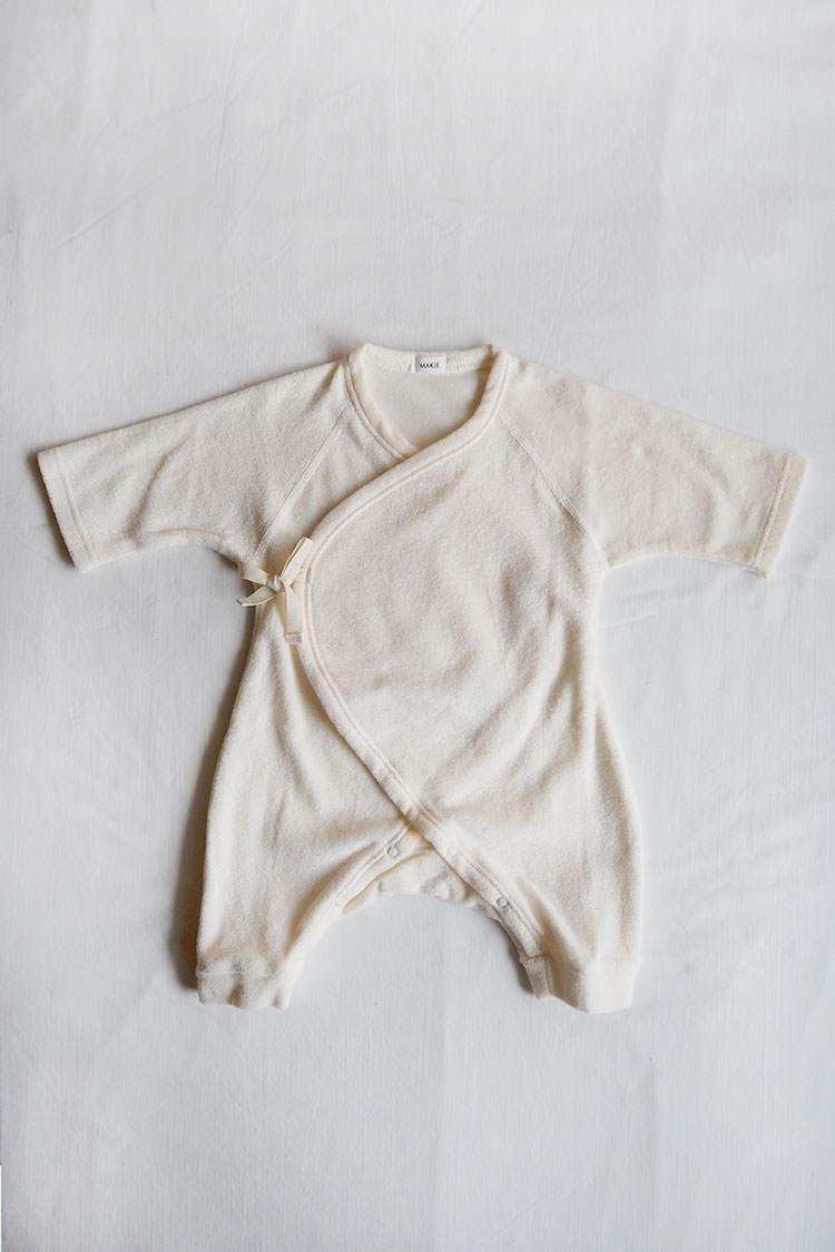 Pile first Hadagi, an ivory kimono style wrap onesie