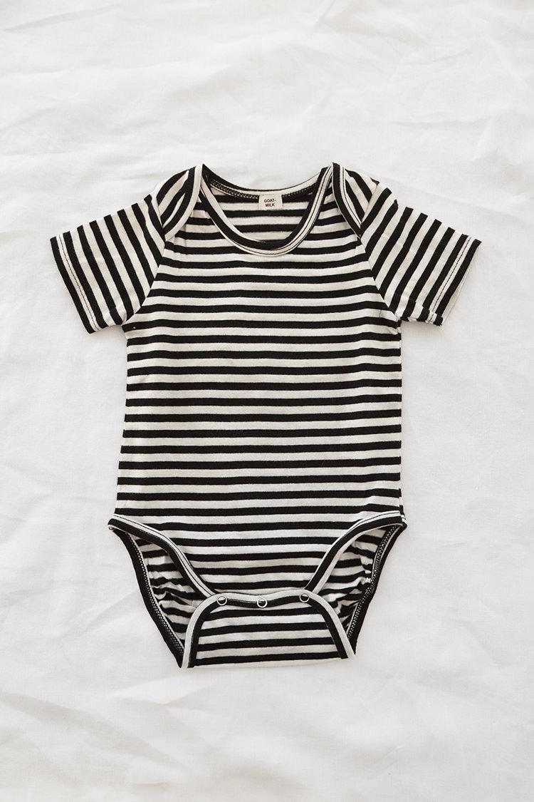 Goat Milk onesie: Black and White Stripe. Top.